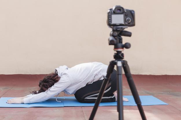 brunette-blogger-recording-yoga-routine_23-2148192284
