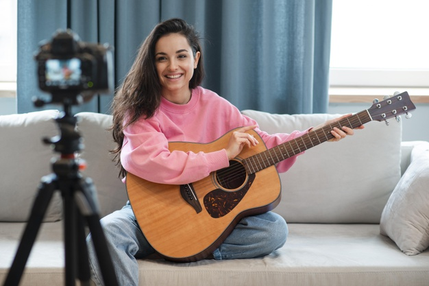 young-blogger-recording-herself-showing-how-play-guitar_23-2148538893